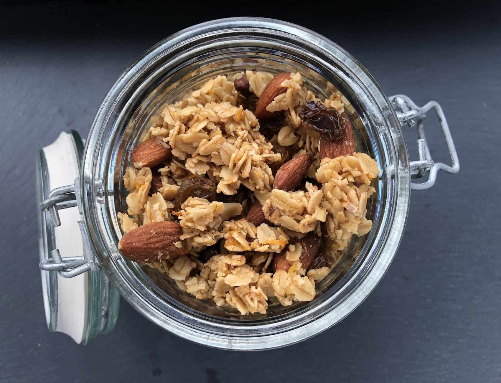 Cookie and Kate Orange & Almond Granola in a glass jar