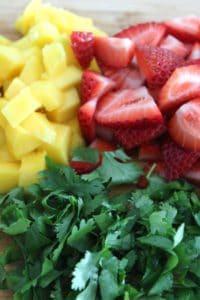 mango, strawberries and cilantro for mango strawberry salsa