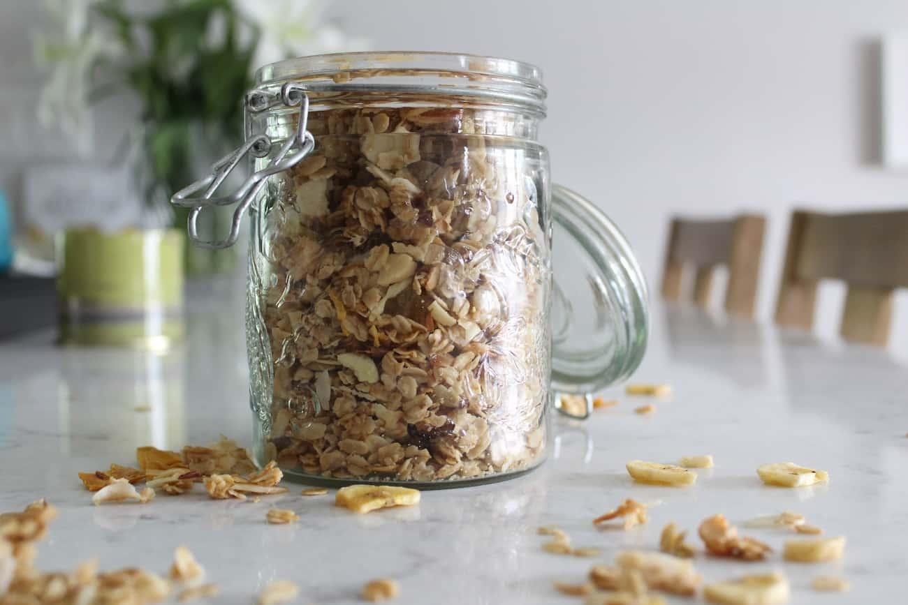 side view jar of pineapple macadamia nut granola