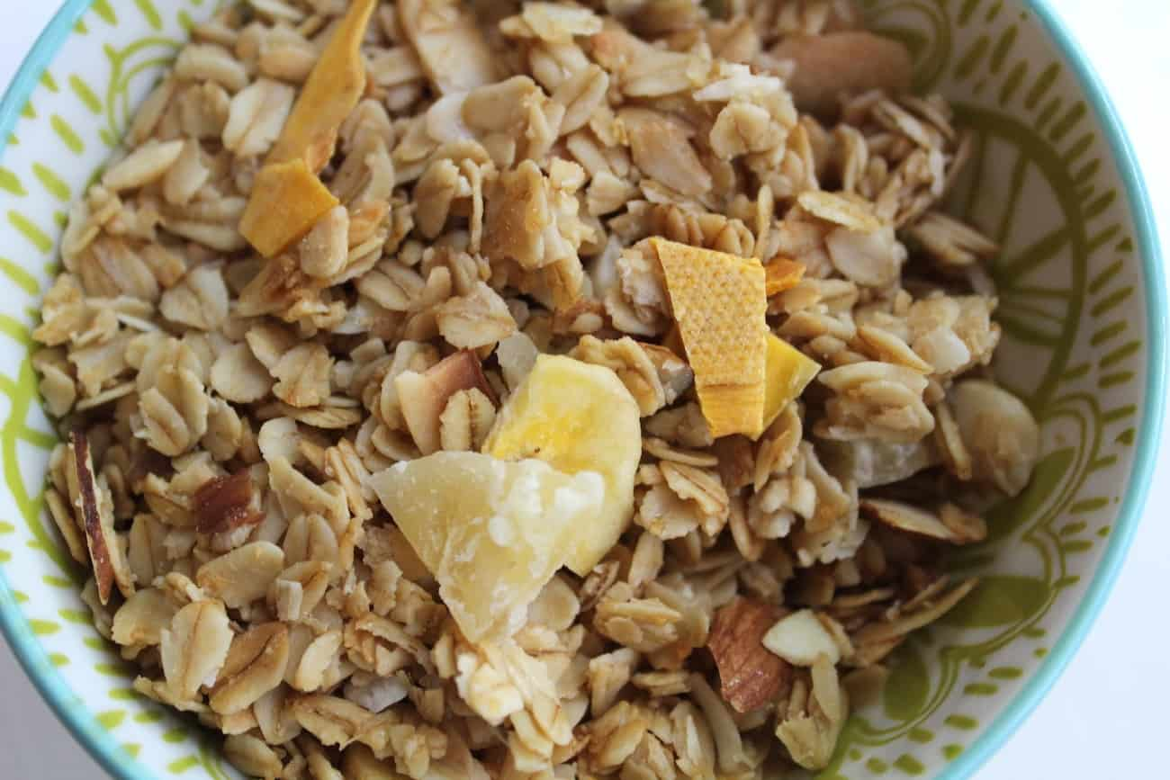 up close view bowl of pineapple macadamia nut granola
