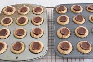 adding a peanut butter cup to cookies