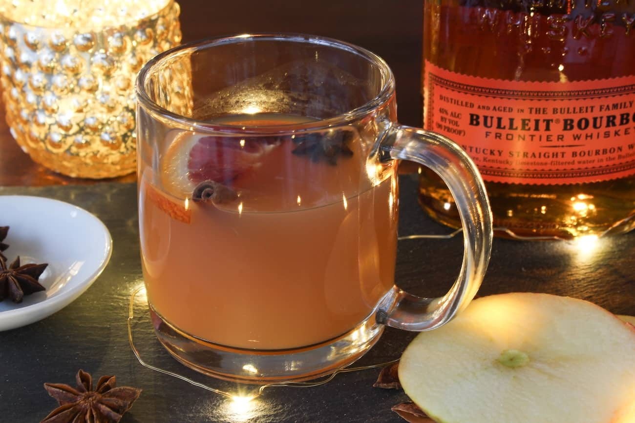 warm apple cider with lights and bulleit