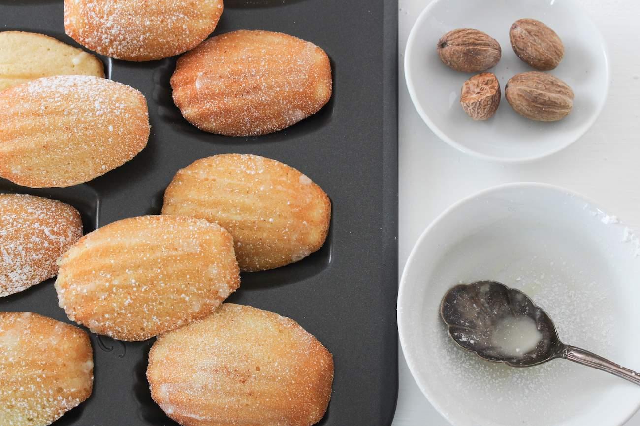 eggnog madeleines with bowl of nutmeg