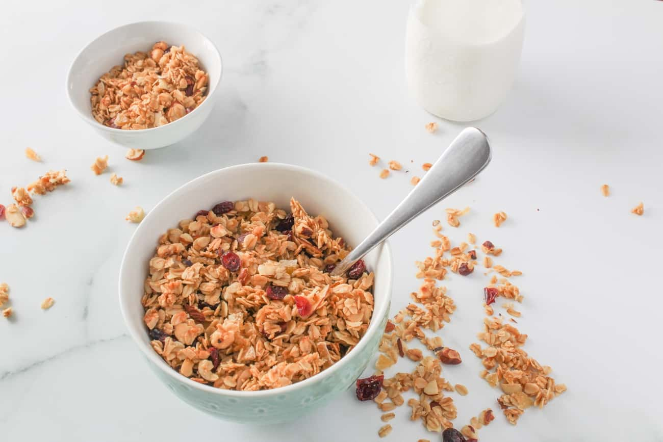 cranberry ginger granola with a bottle of milk
