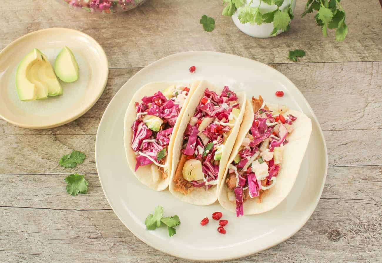 slow cooker chicken tacos with garnishes