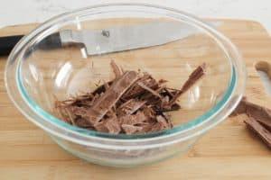 adding warm heavy cream to chocolate for ganache